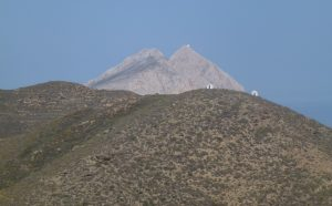 The mitre-shaped hill of Kalamos with its chapel of the Virgin daringly built upon its peak